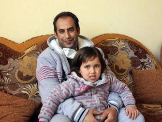 Dr. Hamad Suleiman Daher, shown here with his youngest daughter, was the first person to receive a kidney transplant in Gaza.