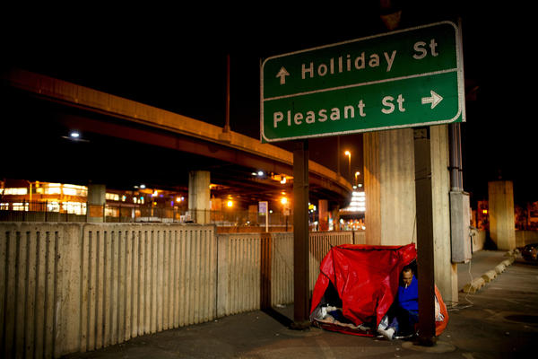 """Tony plugs a small heater into an outlet in the parking lot. """"We're sort of living high class compared to what these people are living,"""" says Andrea, referring to the dozens of others sleeping nearby. """"We're warm at night. These people are freezing to death."""""""