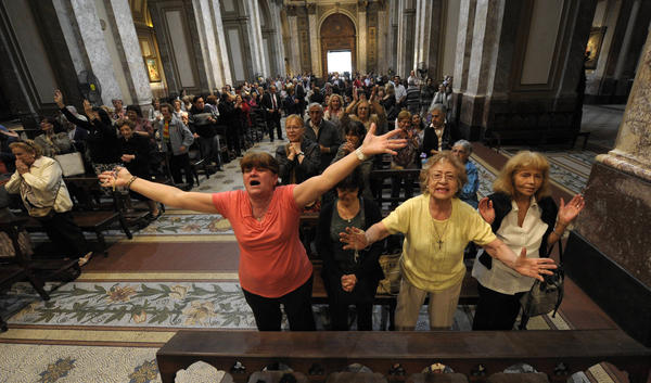 Faithful react after the announcement that Buenos Aires archbishop Jorge Mario Bergoglio was elected Pope Francis I, at Metropolitan Cathedral in Buenos Aires on Wednesday.
