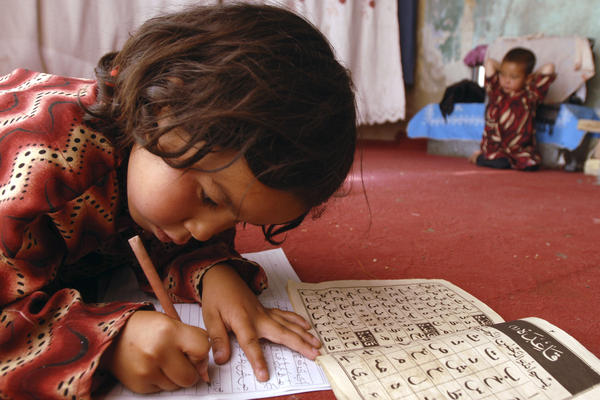 Laila, 7, works on homework in her home in Kabul, 2008.