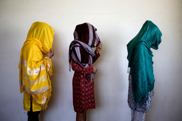 Arazo, 19 (from right), Tabasum, 20, and Shamayal, 25, who fled from abusive family members, stand for a picture in Kabul, 2009.
