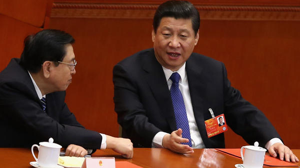 China's new president, Xi Jinping, right, talks with Chairman of the National People's Congress Zhang Dejiang on Friday, March 15. Xi has vowed to deal with widespread corruption, an endemic problem in China.