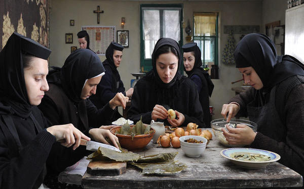 A group of nuns shares a meal in <em>Beyond the Hills</em>. Though the director is hesitant to underline metaphors in his film, contemporary observers won't find it hard to discover what seems like suggestive references to the Romania of dictator Nicolai Ceaucescu.