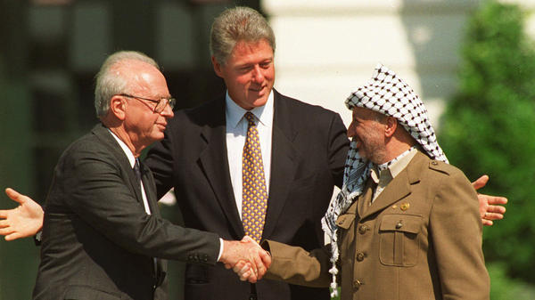 With President Clinton presiding, Israeli Prime Minister Yitzhak Rabin (left) and Palestinian leader Yasser Arafat signed an interim peace accord at the White House in 1993. Twenty years later, President Obama is heading to the region with peace efforts in the deep freeze.