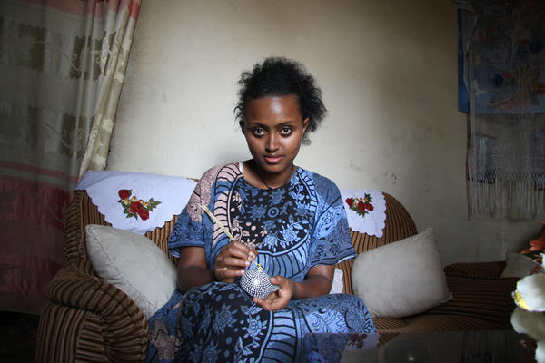 Woman sculpting a clay pot in Addis Ababa, the capital of Ethiopia, June 2011
