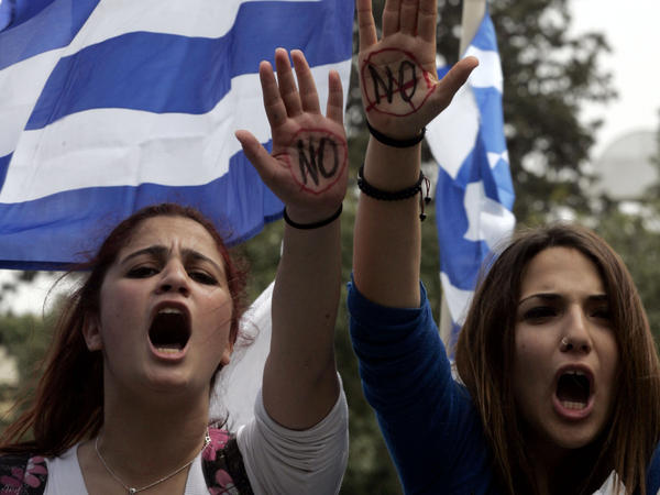 Students in the Cypriot capital, Nicosia, protest against austerity measures in front of the presidential residence.