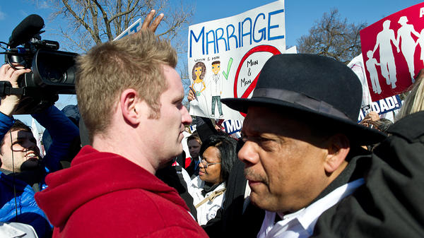 A member of the New York Hispanic Clergy Organization (right) is confronted by a pro-gay-marriage activist outside the Supreme Court on Tuesday.