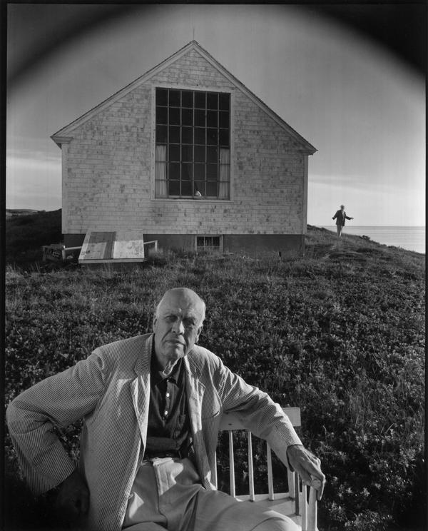 American painter Edward Hopper in Truro, Mass., with his wife, Jo, in the background, 1960