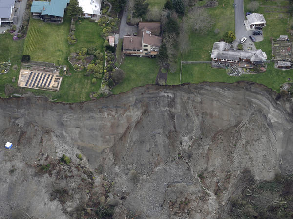 Houses sit near the edge of a landslide on Whidbey Island on Wednesday.
