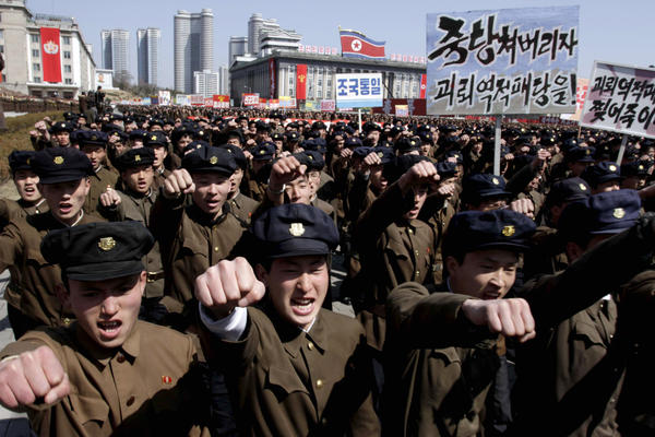 University students march through Kim Il Sung Square in downtown Pyongyang, North Korea, on Friday. Tens of thousands of North Koreans turned out for the mass rally at the main square in Pyongyang in support of  leader Kim Jong Un's call to arms.