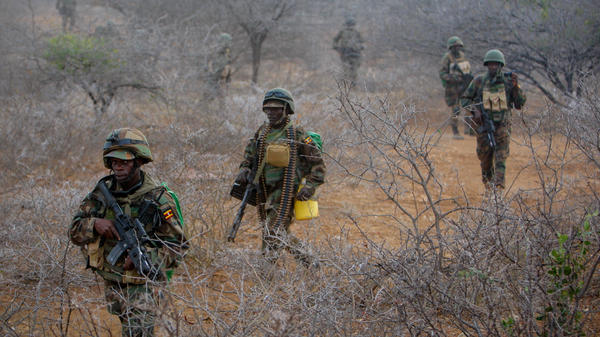 Ugandan soldiers serving with the African Union Mission in Somalia prepare to advance on the central Somali town of Buur-Hakba.