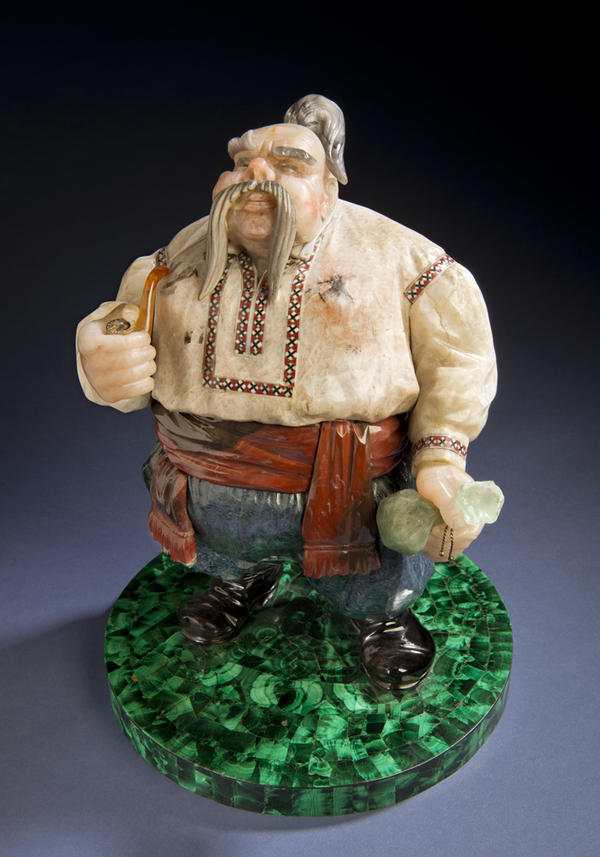 <em><em>Cossack,</em></em> completed in 1979, is another classic image, which reflects Konovalenko's Ukrainian heritage. It was completed in 1979. The base of the sculpture is nephrite; the Cossack's shirt is cacholong, a form of opal, and includes enamel inlay. It measures about 11 inches tall.