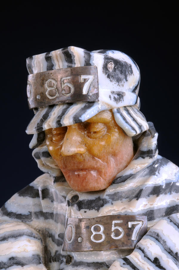 <em>Prisoners</em> was finished between the 1981 and 1984 period. Konovalenko manipulated banded obsidian to create the correct angles for the man's uniform. The sculptor also took advantage of the natural flaws in the Beloretsk quartz he used for the face; the man appears jaundiced, frostbitten and severely unhappy, as one might expect.
