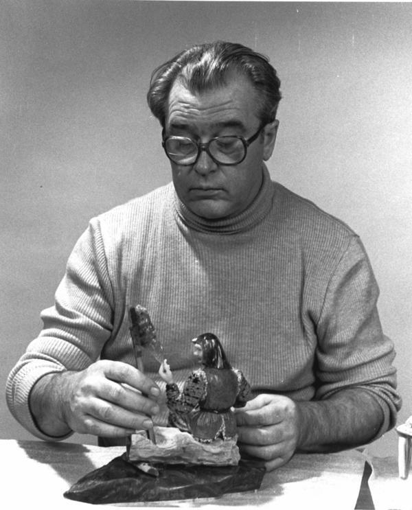 Set designer turned sculptor Vasily Konovalenko (ca. 1984) is seen with a work titled <em>Grandmother</em>.