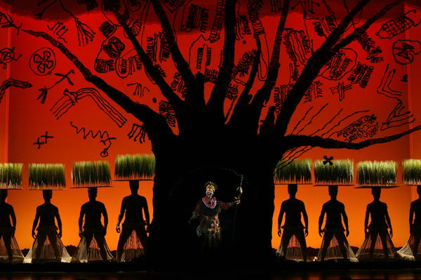 Tshidi Manye (center) as the baboon narrator Rafiki, with the ensemble of <em>The Lion King</em>. The long-running adaptation of the popular Disney animated film has been on Broadway for 15 years.