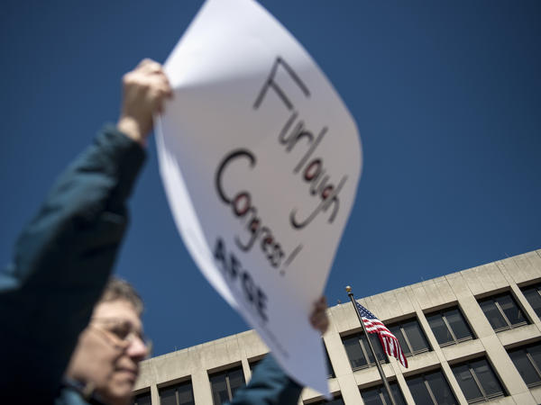 Members of the American Federation of Government Employees protest mandatory federal budget cuts during a rally March 20 in Washington, D.C.