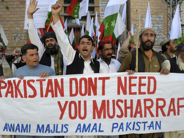 Pakistanis in Quetta protest against former military ruler Pervez Musharraf on March 24, the day Musharraf returned home after more than four years in exile. But his attempt to stand in upcoming elections is facing multiple legal challenges.