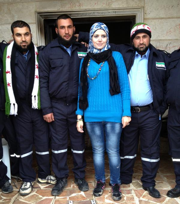 Razan Shalab Al-Sham, in bright blue, works for the Syrian Emergency Task Force. She helped provide uniforms for the new civil police force of Khirbet al-Joz in northern Syria.
