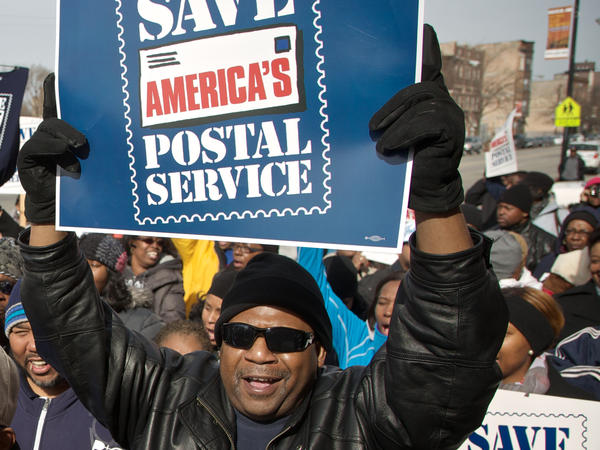 A Chicago postal worker protests in support of Saturday mail delivery in February.