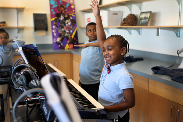 Jionni Anderson is a third grader at Savoy Elementary School. Anderson raises her hand to answer a question in Mr. Scott's keyboard class.