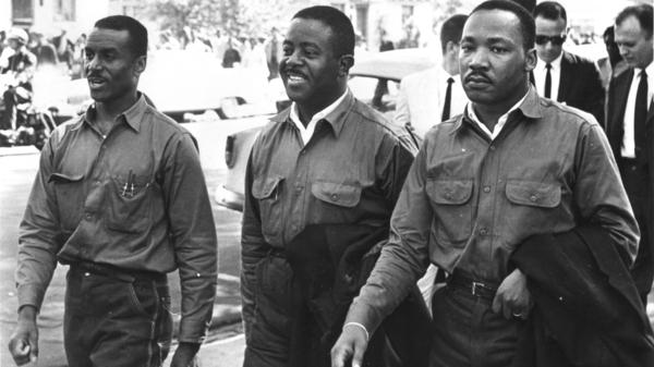 "Martin Luther King Jr., with the Rev. Ralph Abernathy (center) and the Rev. Fred Shuttlesworth, defied an injunction against protesting on Good Friday in 1963. They were arrested and held in solitary confinement in the Birmingham jail where King wrote his famous ""Letter From Birmingham Jail."""