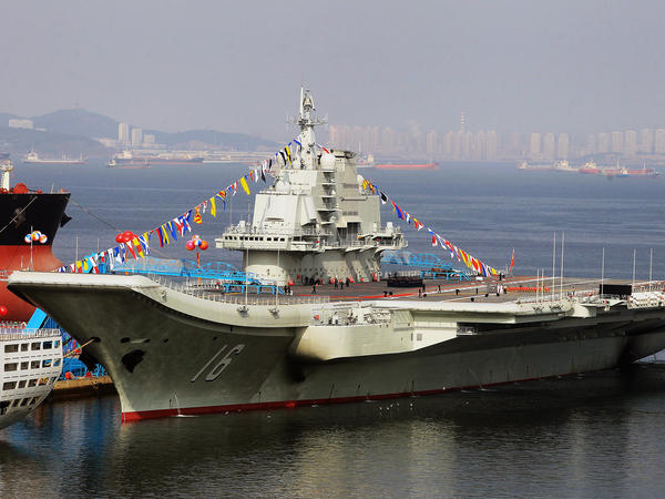 "The Russian-built ""Liaoning"", China's first aircraft carrier, is a potent symbol of the country's growing military might."