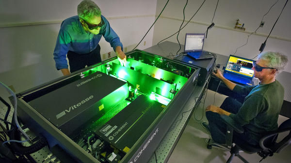 Ian Sharp (left) and Joel Ager use lasers to study the properties of water-splitting materials. The goal is to improve the efficiency with which solar energy can be used to create chemical fuel.