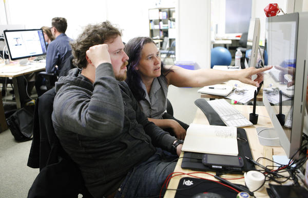 Sarah Allen, CEO of Blazing Cloud, works with user experience designer Anton Zadorozhnyy in the company's offices in San Francisco.