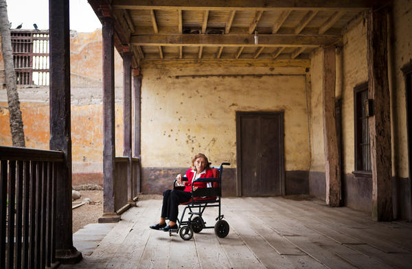 Dora Sabina Barrantes Enriquez poses for a photograph in front of the home she has lived in since 1942. Some historians date the home back to the 1600s, and the property was registered as a historical building. The building was part of the grand Hacienda San Agustin, once inhabited by one of Peru's most wealthy and powerful families. It was demolished.