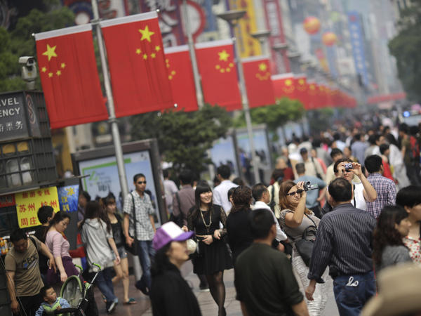 A crowd strolls on a pedestrian street during a recent holiday in Shanghai.