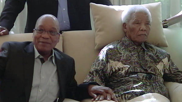 In this image taken from video, South African President Jacob Zuma sits with ailing anti-apartheid icon Nelson Mandela on Monday. Mandela was hospitalized in late March with a lung infection, and in images from the visit, appeared largely unresponsive.