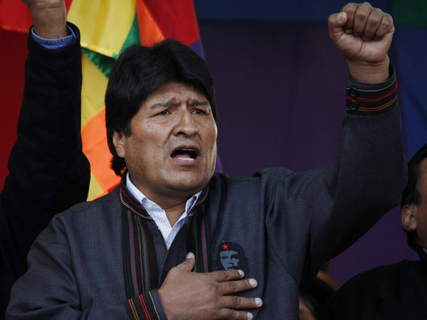 Bolivian President Evo Morales sings his national anthem during the annual May Day march in La Paz on Wednesday. He announced during a speech that he was expelling the U.S. Agency for International Development from the country.
