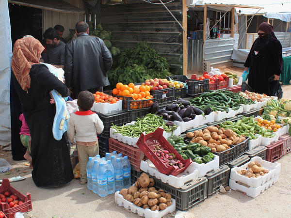 Syrian refugees shop at a makeshift grocery store at the Zaatari camp in March.