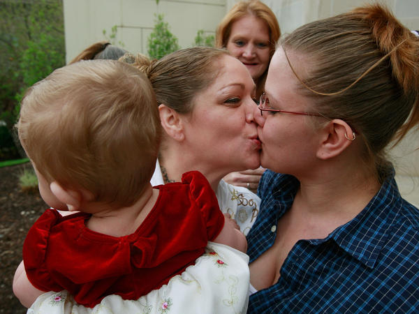 An Iowa couple and their daughter after a wedding ceremony on the first day same-sex marriage was legal in the state, in April 2009.