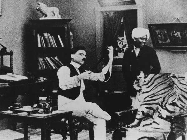 Dhundiraj Govind Phalke (left), known as the father of Indian cinema, examines a filmstrip.