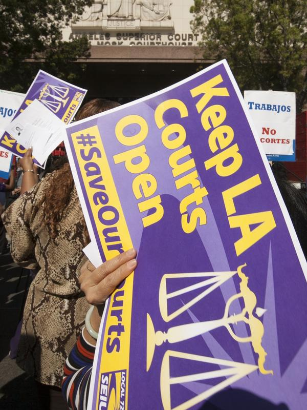 Members of the Save Our Courts coalition rally outside the Los Angeles County Courthouse in March. The county will soon cut the number of courthouses handling small claims cases from 27 to six.