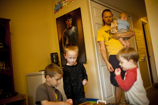 Jonathan oversees playtime with Egan and his neighborhood friends.