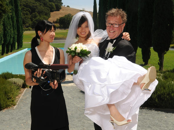 Filmmaker Debbie Lum poses with Steven and Sandy, her documentary subjects, on their wedding day.