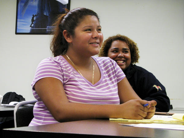 Jackeline Lizama (front) plans to attend a local community college after she graduates next month from her high school in Silver Spring, Md.