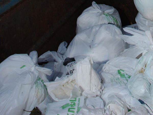 Portland recycling handlers say they've seen more diapers in recycling bins after the city switched to biweekly trash pickups. A file photo shows bags of diapers in a container at a California recycling facility.