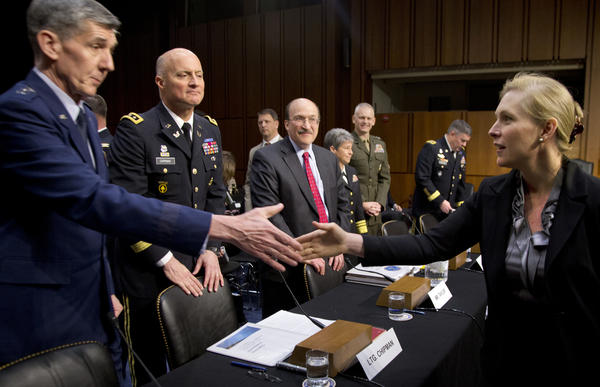Sen. Kirsten Gillibrand greets panel members from the military and the Defense Department testifying on Capitol Hill on March 13 before the subcommittee's hearing on sexual assault in the military.