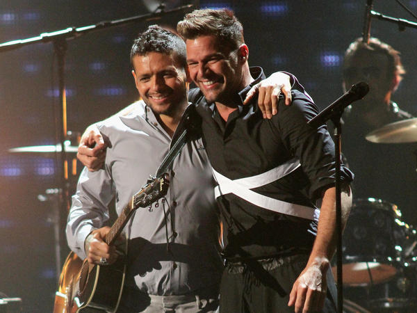 Former bandmates Draco Rosa and Ricky Martin, seen here on stage at Univision's 2013 <em>Premio Lo Nuestro </em>awards celebration, reunite on Rosa's new album, <em>Vida</em>.