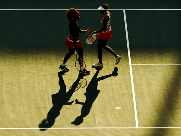 Serena (left) and Venus Williams celebrate a point  during their women's doubles match at the U.S. Open tennis tournament in August 2012.