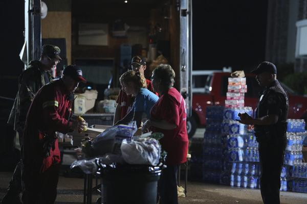 Members of the American Red Cross distribute food at a command center the day after a tornado hit in Moore, Okla., with estimated winds of up to 200 mph. A 1999 storm in Moore caused similar damage and loss of life.