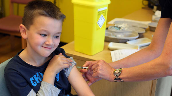Luke Tanner, 7, gets vaccinated for measles at a clinic near Swansea, Wales, in April. Wales is at the center of a measles outbreak that has been linked to one death.