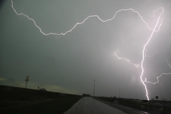 Lightning strikes over Interstate 35 near Moore on Tuesday. Thunderstorms and lightning slowed the rescue effort, but more than 100 people had been pulled from the debris alive.