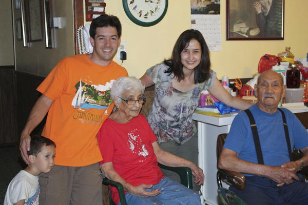 Elysha, husband Michael and one of their sons with Elysha's grandparents, Evelia and Homer Patino.