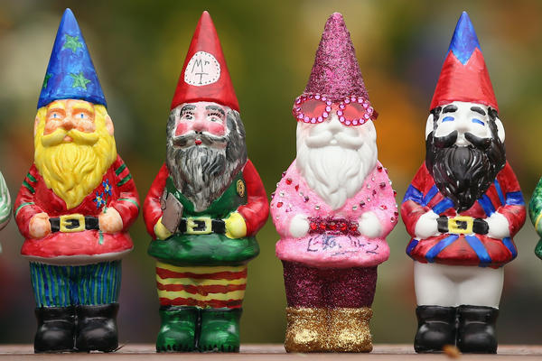 Decorated gnomes designed by celebrities, including Elton John (his gnome is second from the right), are featured at the Chelsea Flower Show in London on Monday.