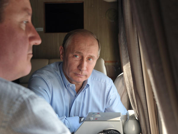 Russian President Vladimir Putin (right) and British Prime Minister David Cameron met earlier this month. Cameron said then that he was encouraged by Russia's willingness to take part in a peace conference on Syria. Now, Russia is said to be angry about the EU's decision to lift an embargo on arming the Syrian opposition.