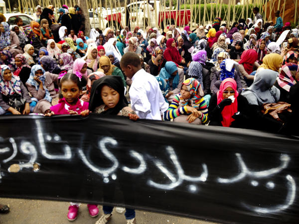 "Residents of the Libyan town of Tawargha were driven from their homes in Libya's 2011 civil war. Girls from the town hold up a sign that says ""we want our homeland, Tawargha"" during a protest outside Libya's Parliament. Residents say they will return next month, which could lead to a showdown."